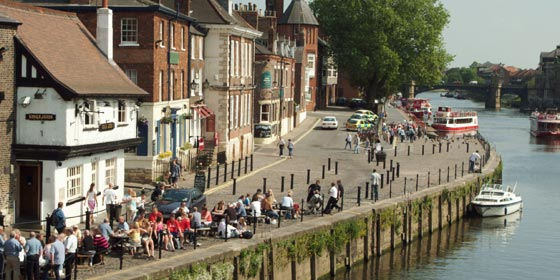 The Kings Arm pub on Kings Staith is very popular for sitting out watching the river